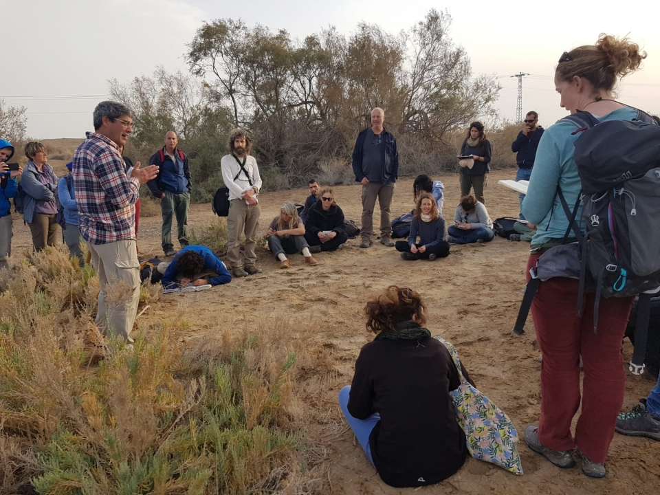 Dr. Yuval Sapir, explaining about salt marsh vegetation in the Judean desert, near the Dead Sea
